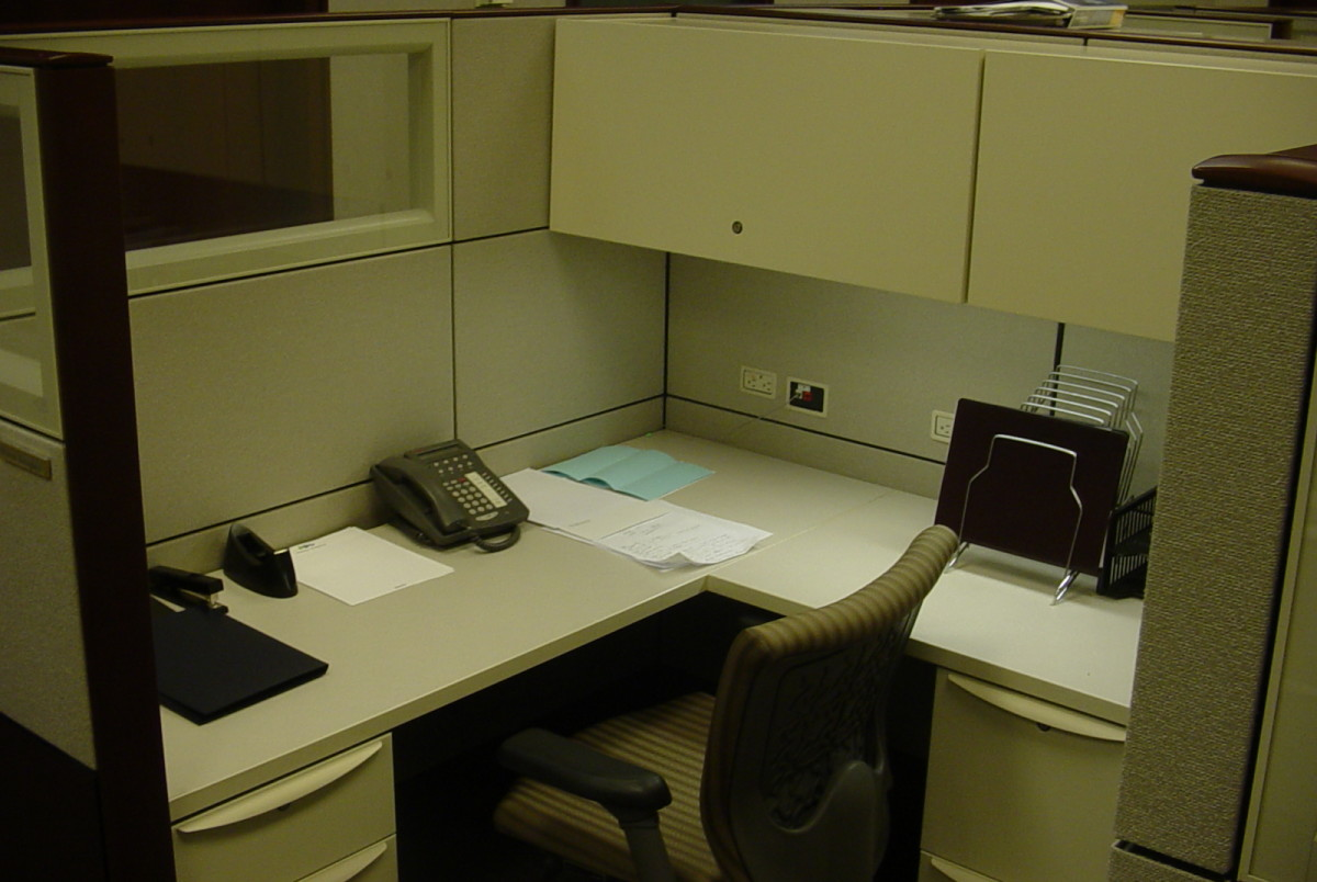 An empty piece of cubicle real estate shows little sign of its former tenant.