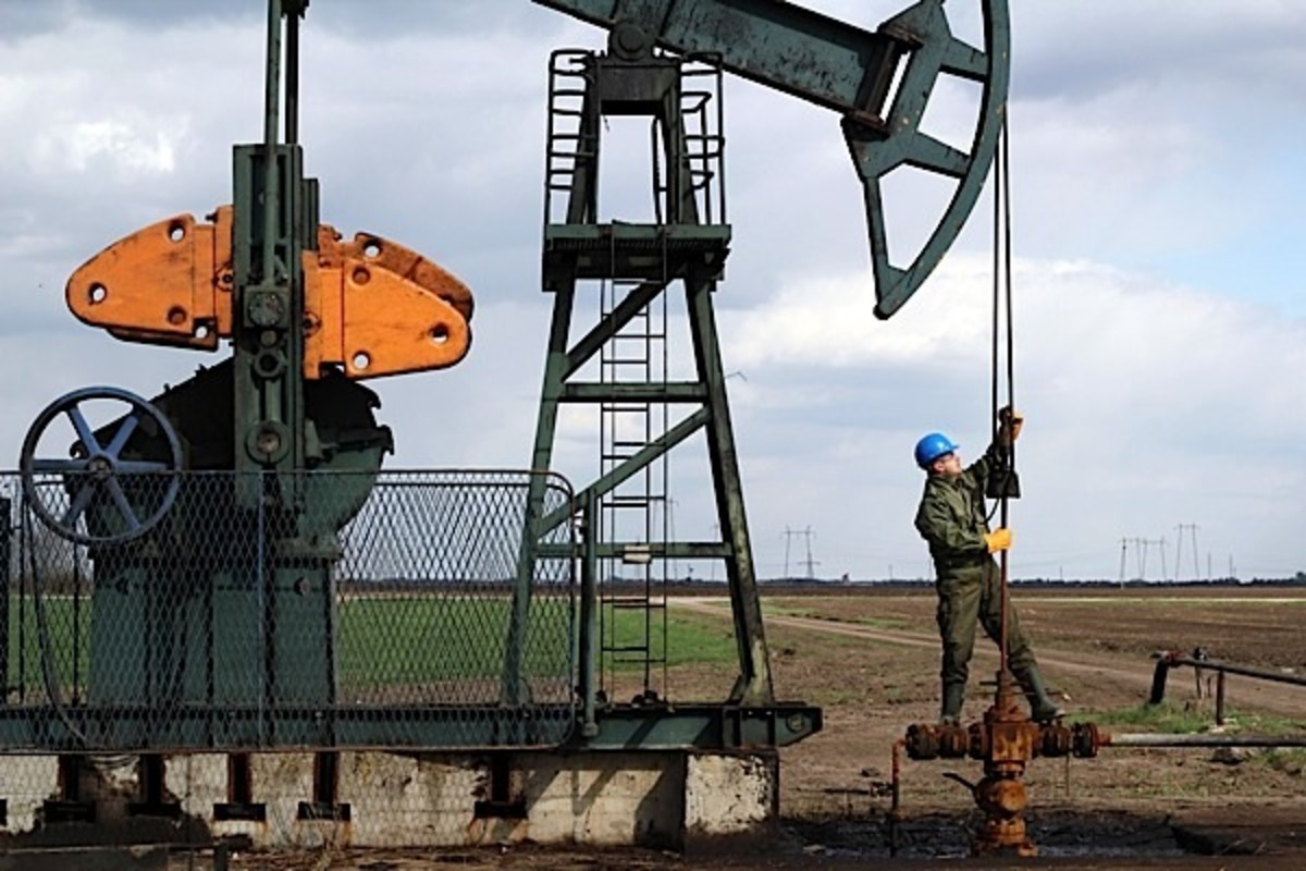 An Oil Field Worker At Work on The Plains of Canada