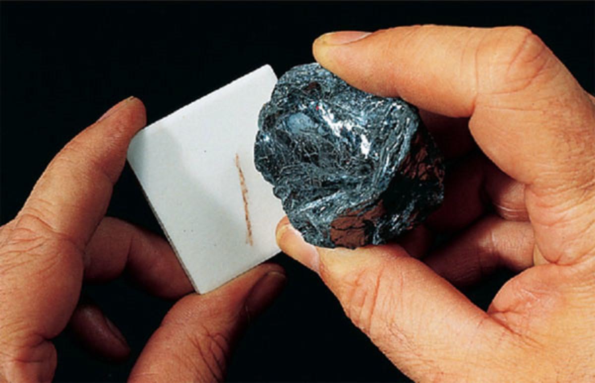 A mineral creating a streak on an unglazed ceramic tile