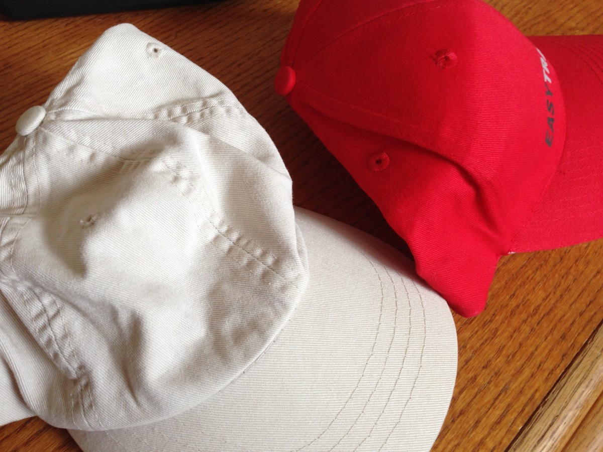 Promotional custom hats can be either soft and unstructured (left) or structured with stiffening materials (right).