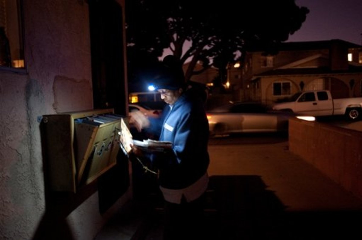 "This letter carrier appears to be quite serene and untroubled by nightfall, having most certainly taken the Chinese proverb ""Better to light a candle than curse the darkness,"" to heart."