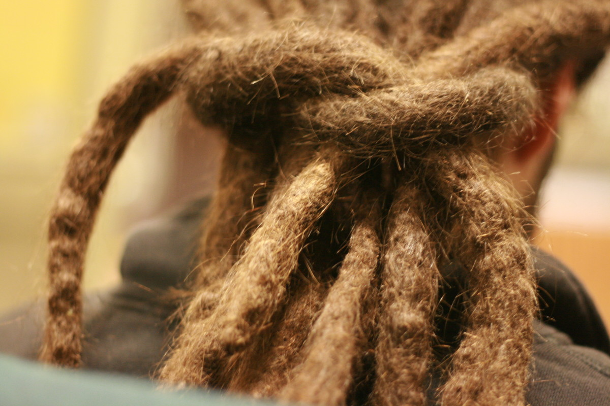 People wear dreadlocks for both religious and non-religious reasons.  Members of the Rastafarian sect often wear dreadlocks and untrimmed beards.  Employers may pressure them to comply with company dress codes.