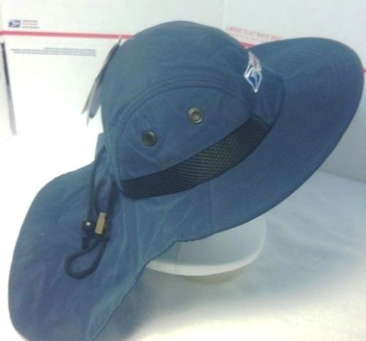 This is one of the best hats you can get as a CCA. It keeps your face out of the sun and cools your neck. It even has a small zippered pocket to store an ice pack or other small items.