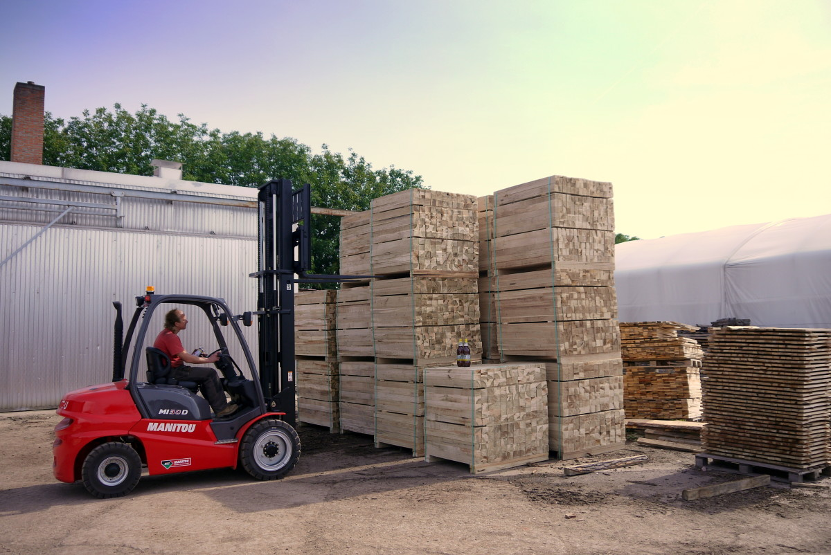 Forklift Operator Stacking Materials
