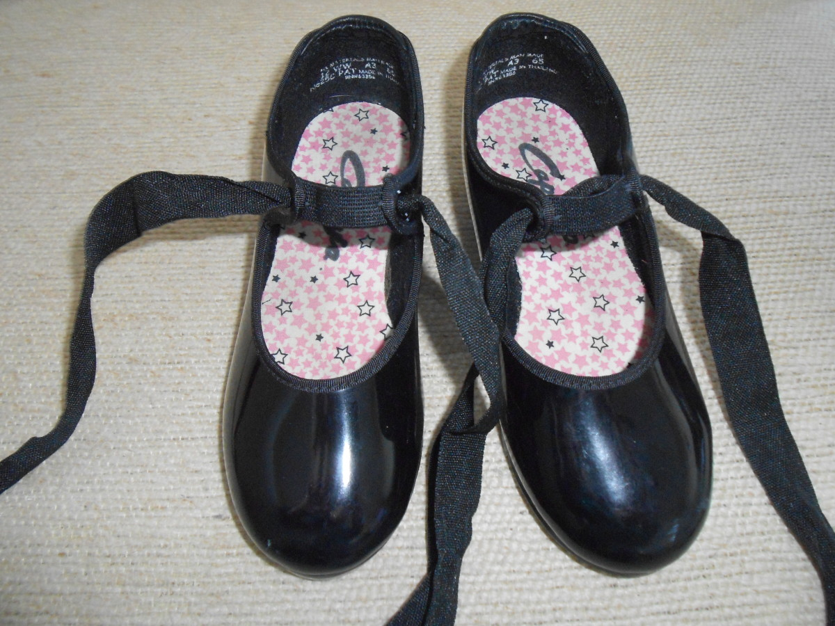 Girls tap shoes bought at a local thrift store for $1.50.