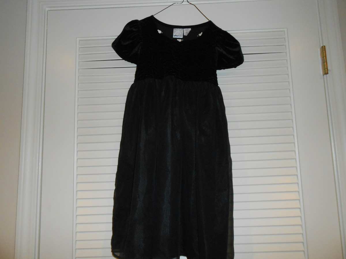 Little girl's black velvet & taffeta dress was $2.92 at Goodwill.