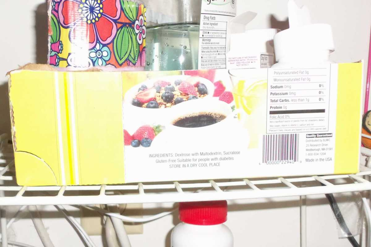 An empty box cut in half to hold items together on a shelf.