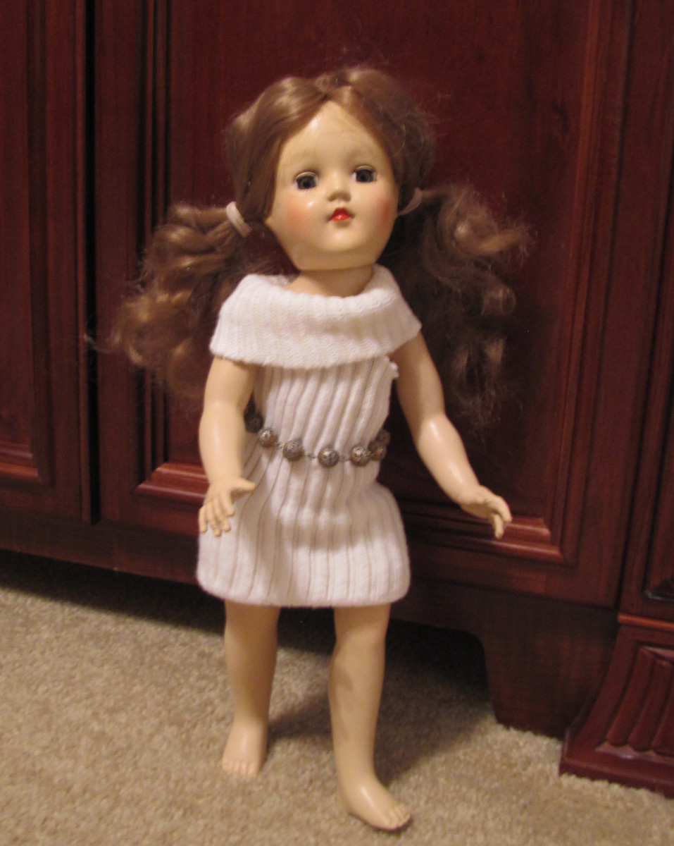 Treat your doll to a sweater dress made from a sock.