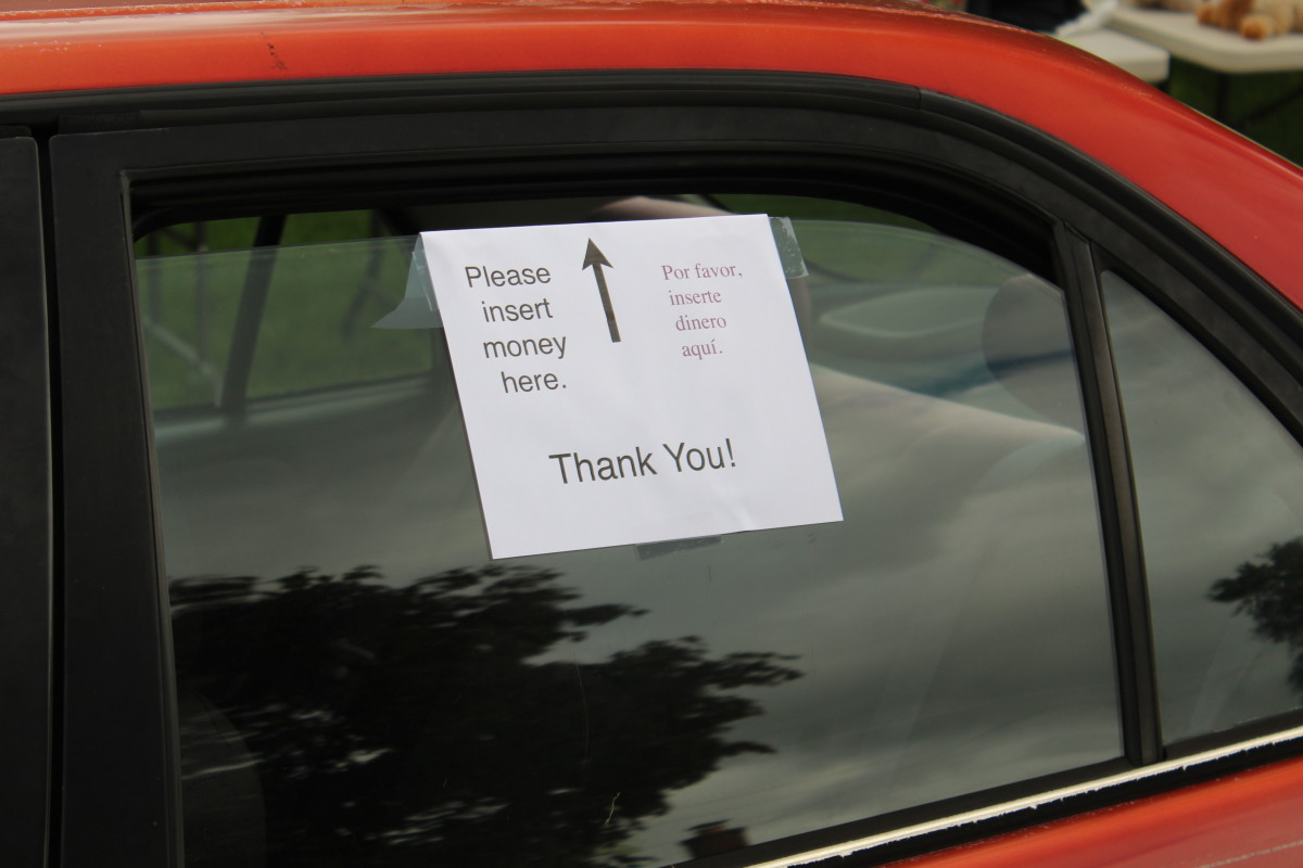 Clear signage helps customers know where to put their money.