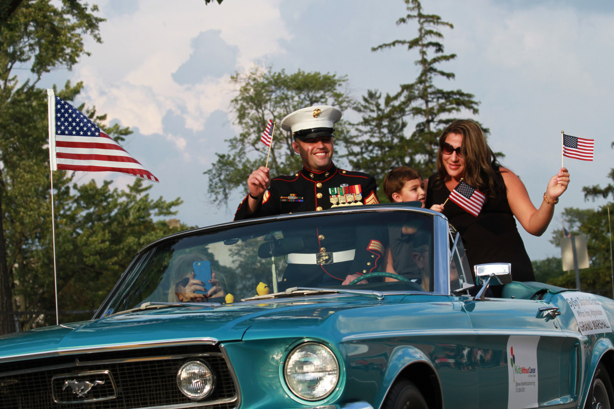 U.S. Marine Corps Gunnery Sgt. Dominic Freda, cruises down Woodward Avenue with his family in 2014.
