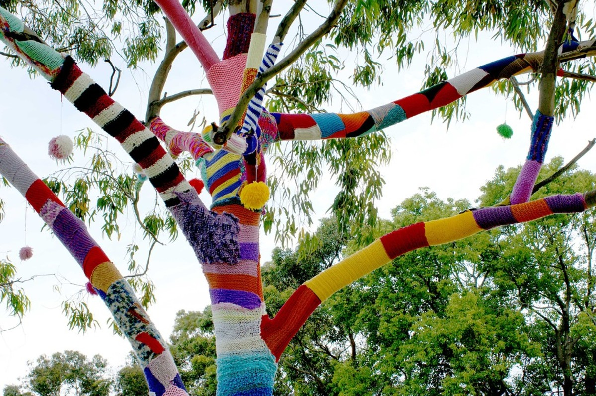 """Birmingham in Stitches is a yearly yarn bombing event in which people knit and crochet covers and accessories for public """"thing"""" like trees, cars, benches, and more."""