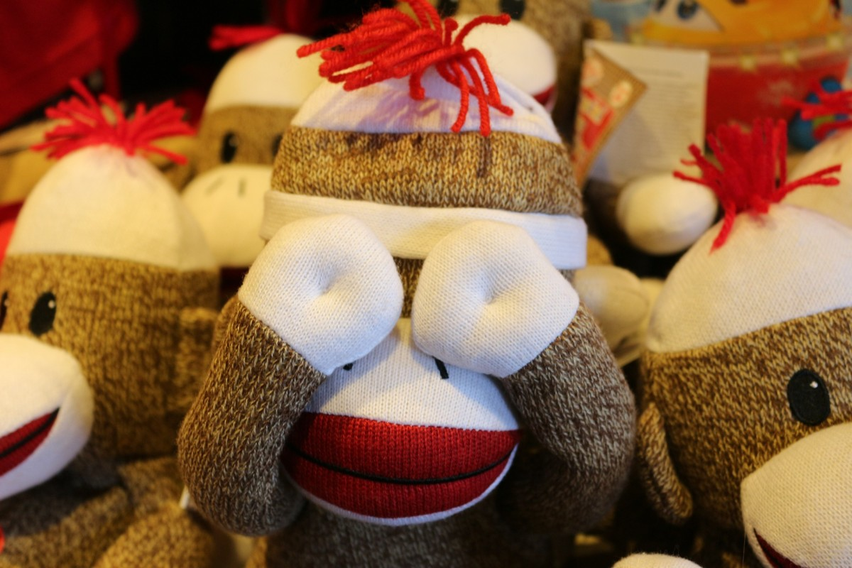 Remember Sock Monkeys? Make some in different colors. It doesn't have to be a monkey. How about a white rabbit with floppy ears (the ankle part of the sock). Use a marker for adding the face or stitch it with yarn.