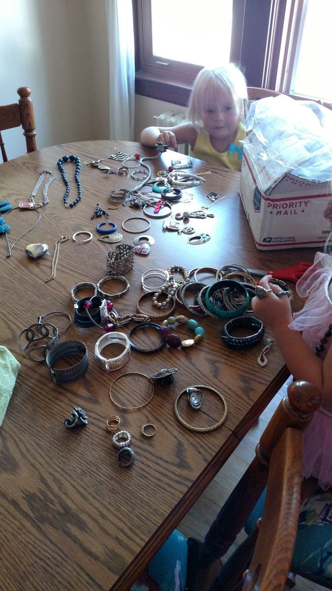Sorting the jewelry, one piece at a time.
