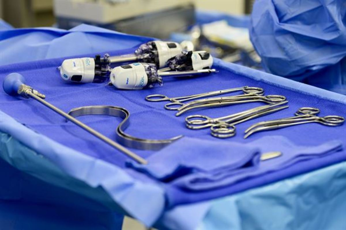 The mayo stand will hold the necessary instrumentation for the surgery.