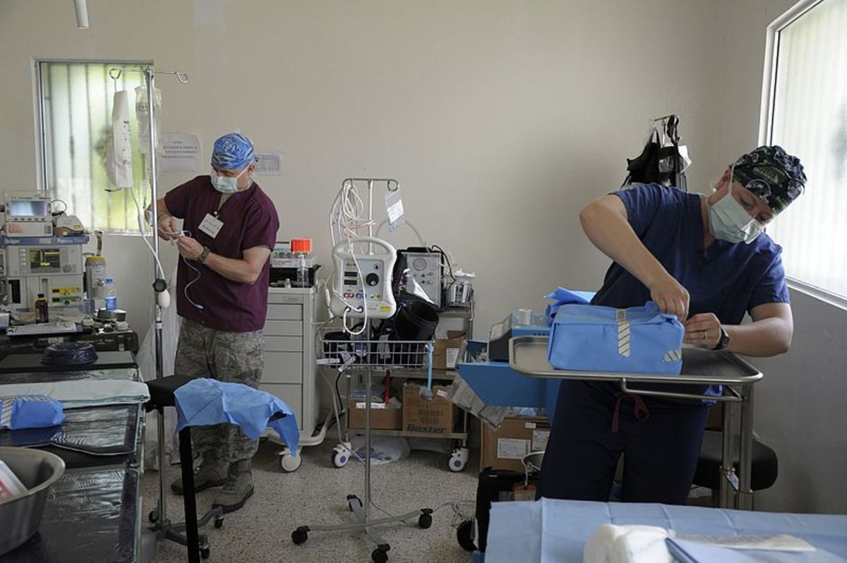 Float nurse assists in getting the OR ready for the next patient