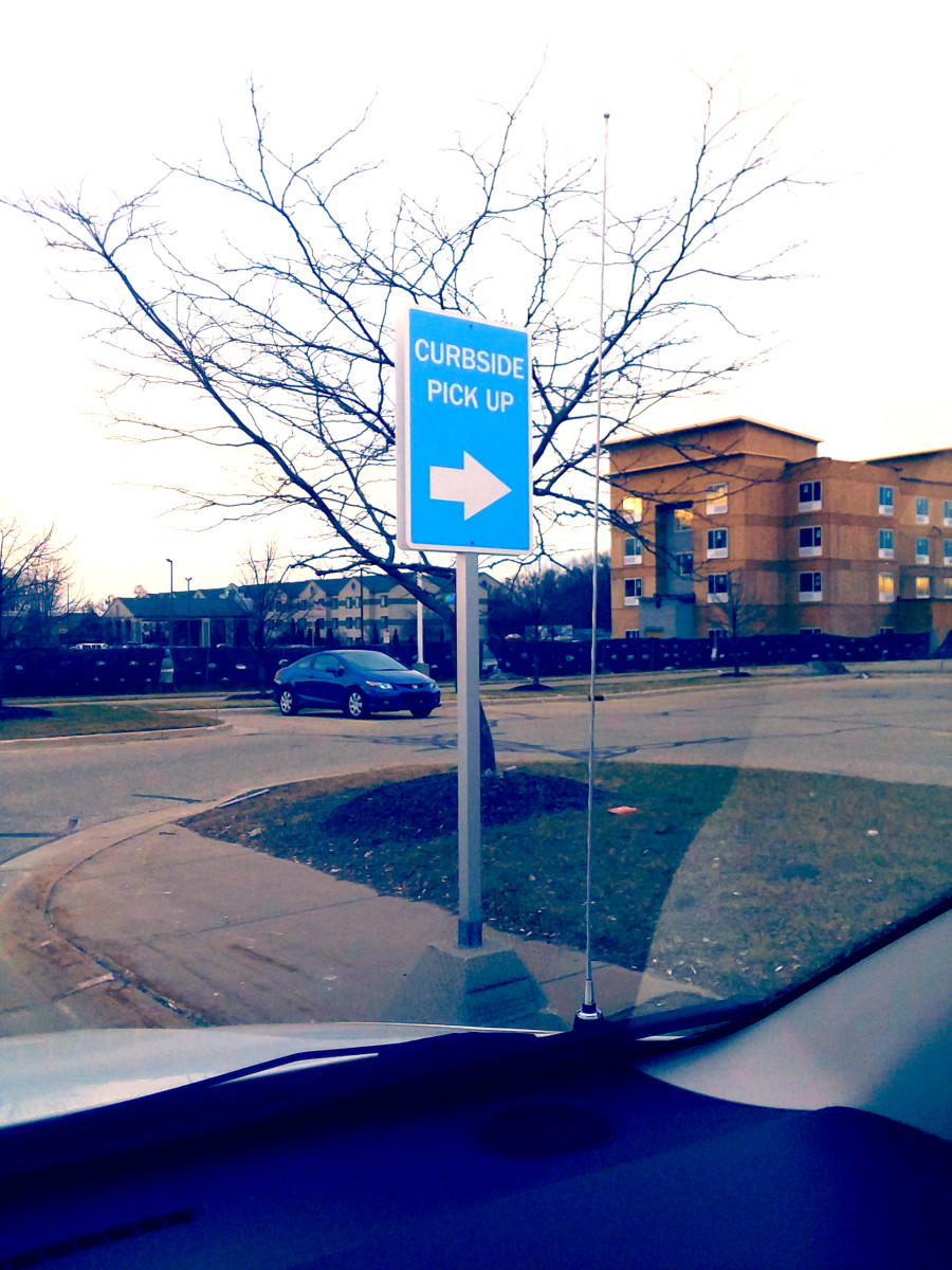 The sign indicating where to go for Meijer Curbside.