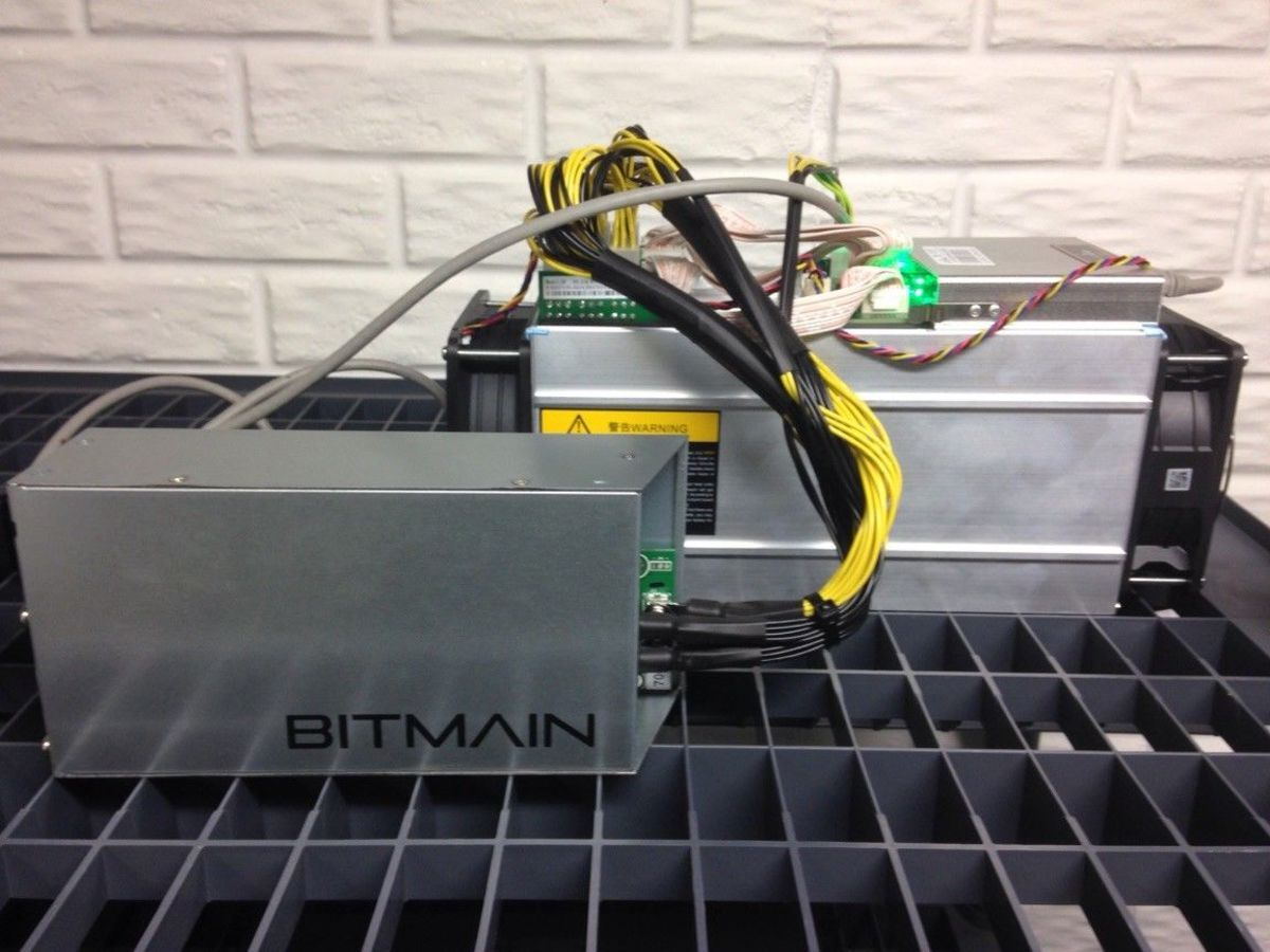Bitmain Antminer S9 ASIC miner and power supply.