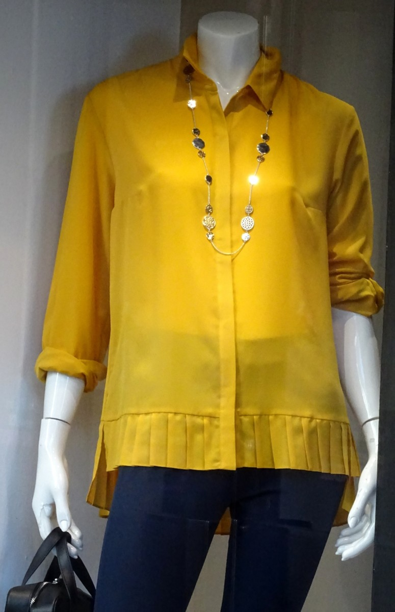 A dress form or mannequin helps display shirts and dresses and make sales.