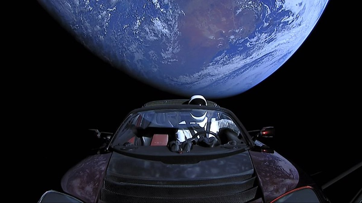 Tesla roadster in orbit around the Earth.