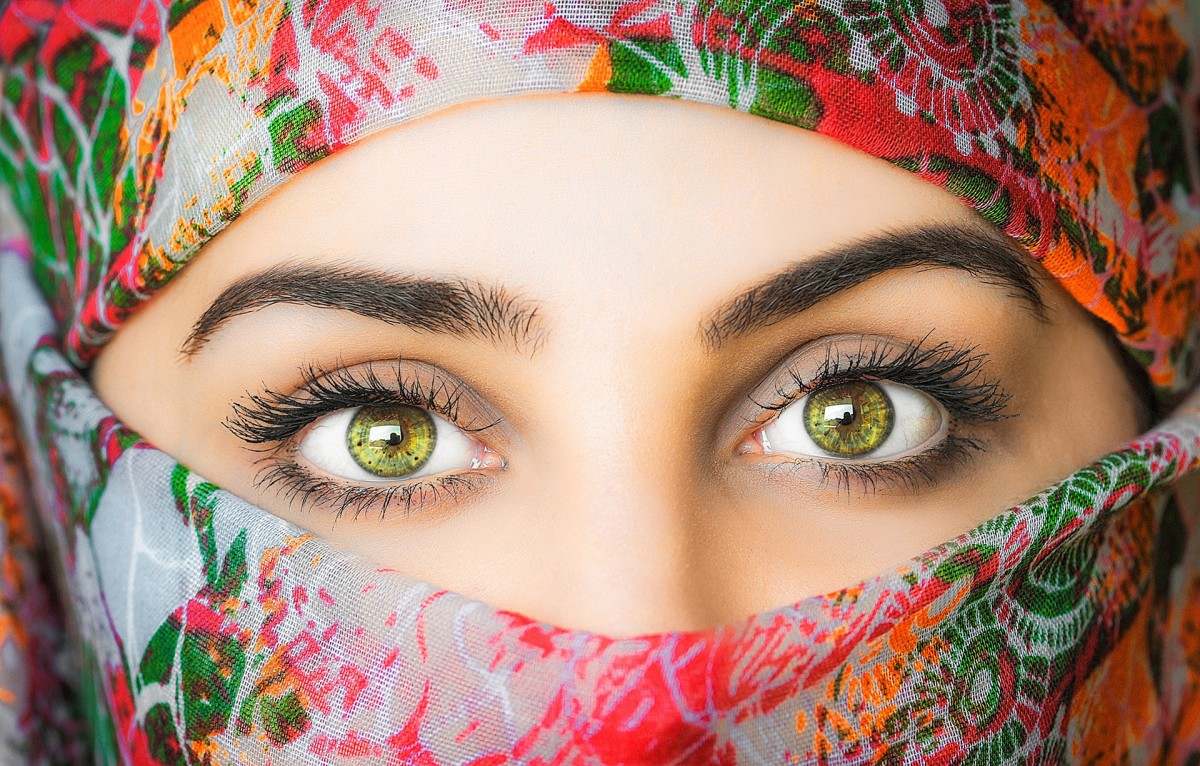 A belly dancer with head wrap exposing her performing eyes.