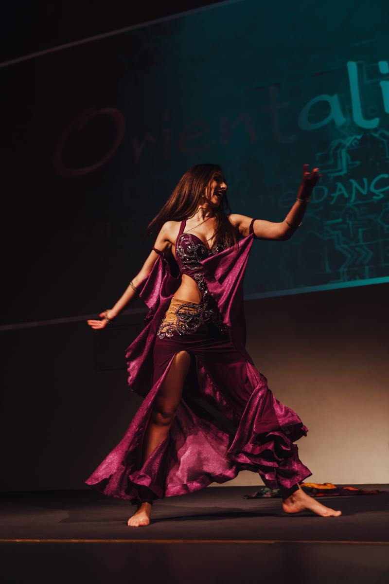Professional belly dancer in performance at a public function.