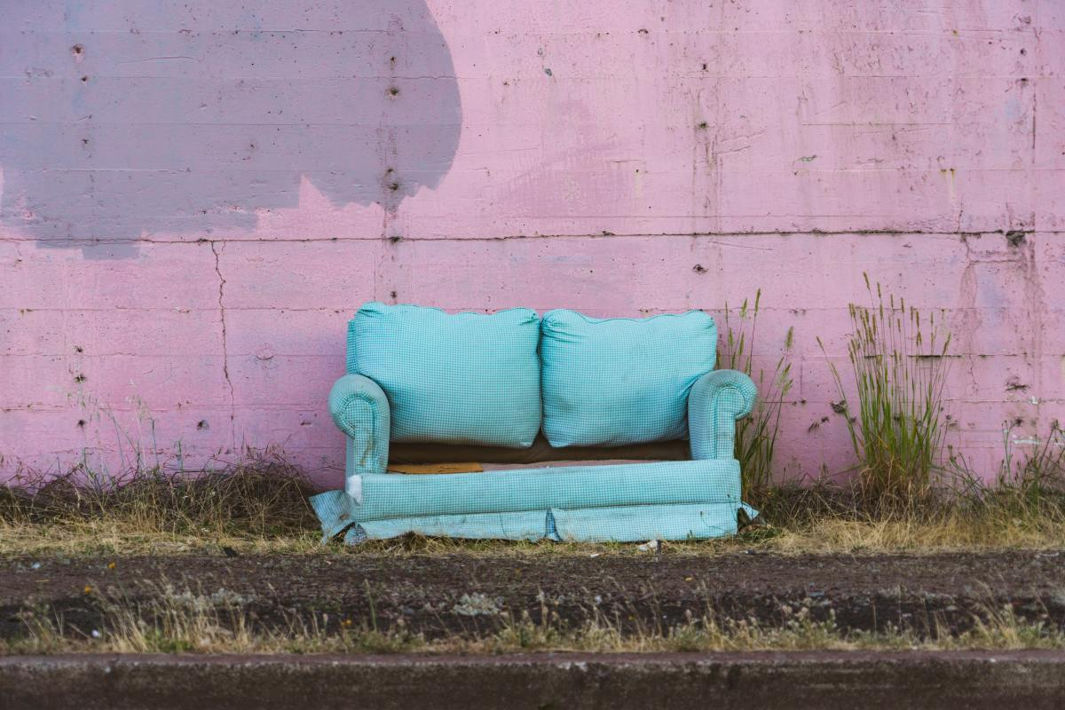 Is this sofa a mess, an eyesore, free stuff...or is it someone's bedroom? It depends on your perspective.