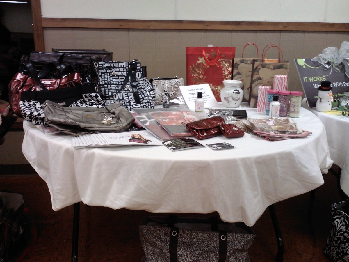 Dalaina's display includes both purse and candle products.  She is introducing new products to the market with a paddle party!