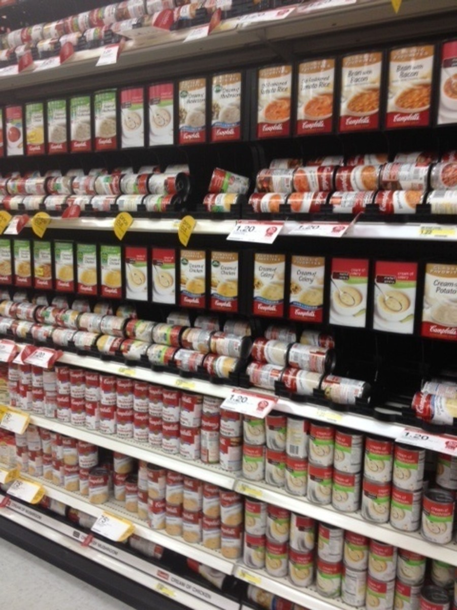 Stocking shelves in preparation for the Thanksgiving holiday or a forecasted hurricane will cause grocery stores to work employees more hours to meet the demand of the local consumers.