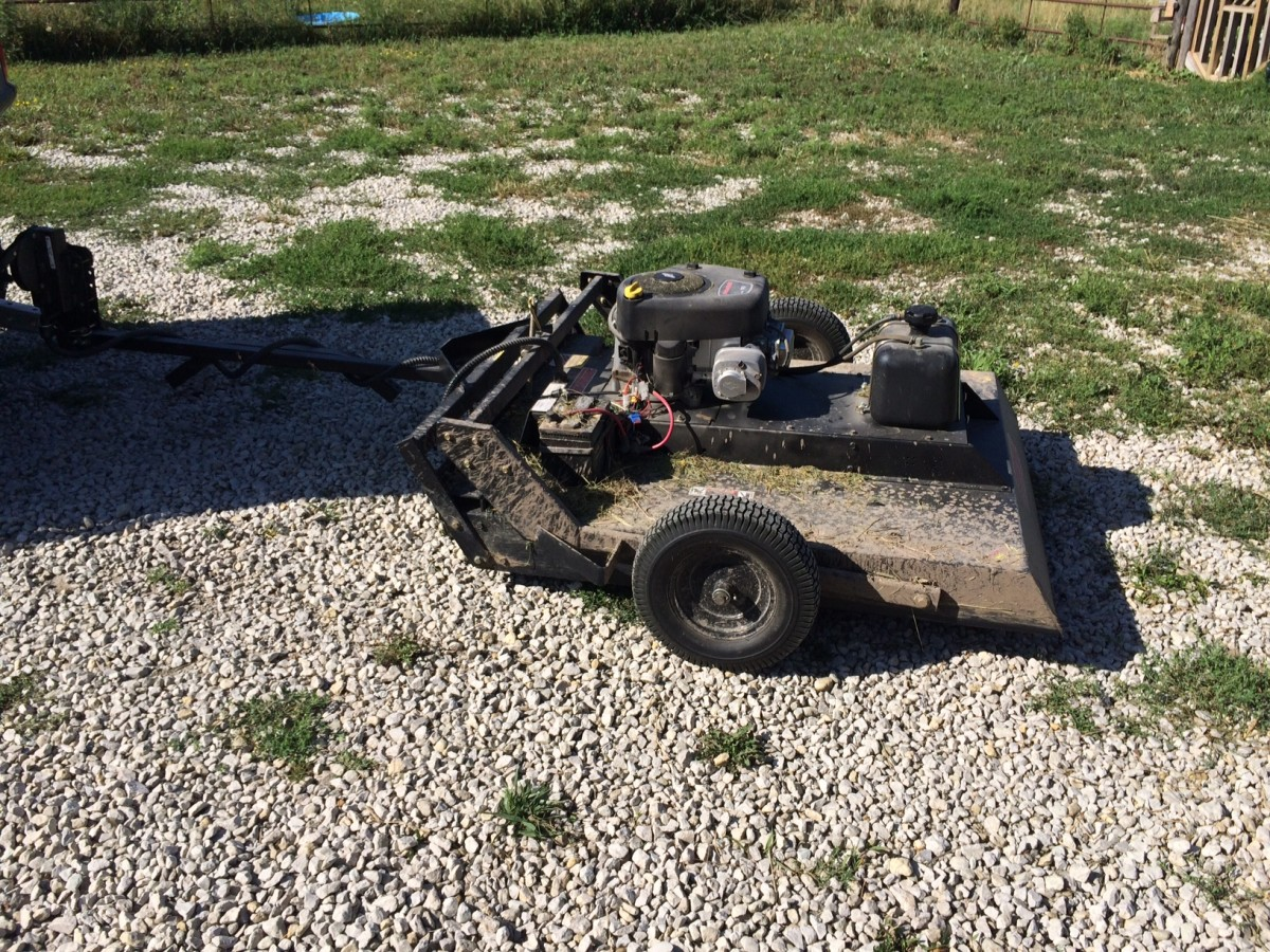 The UTV trail mower or bush hog can be used to clear a field.