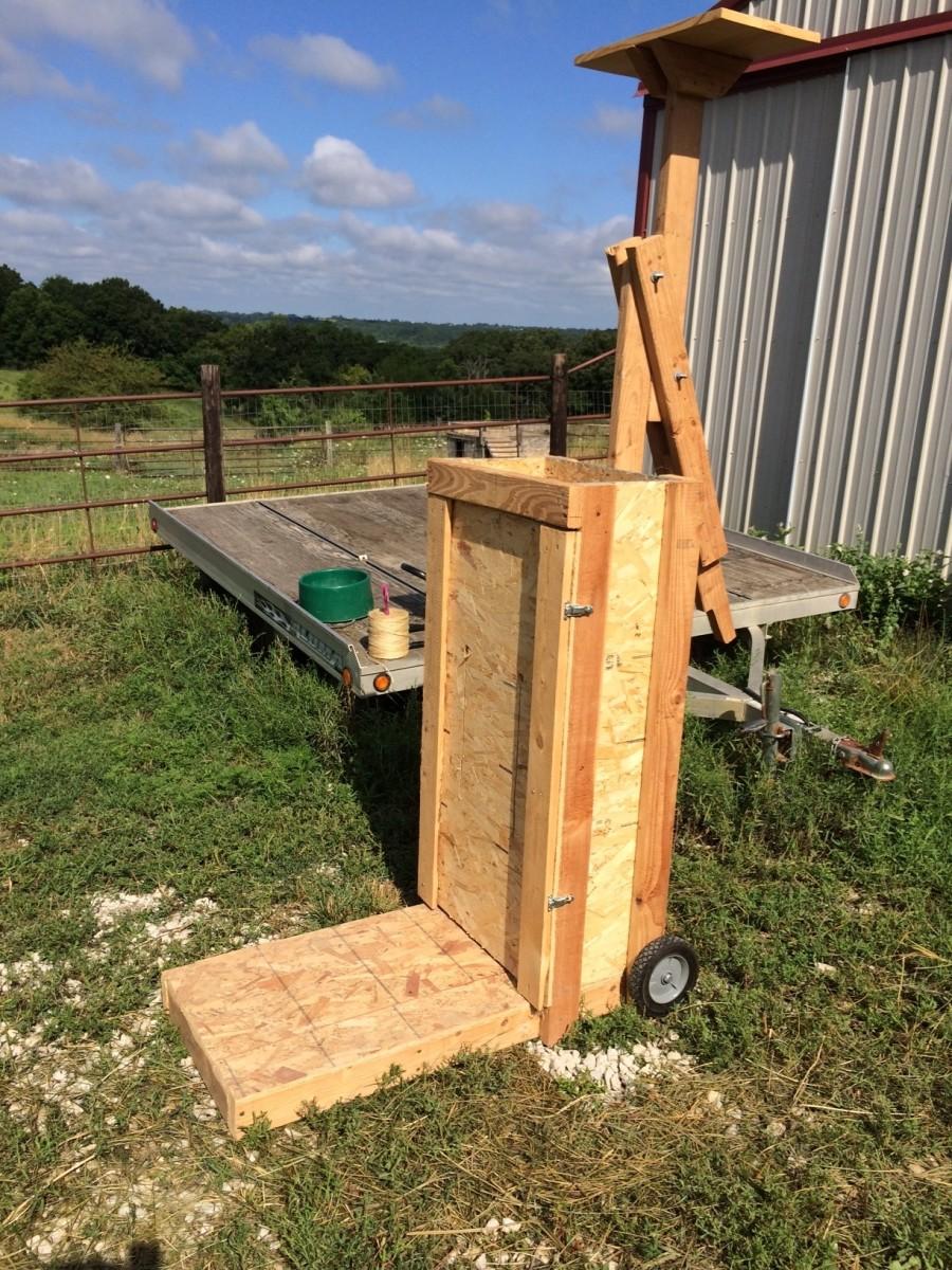 Box baler made from scrap wood.