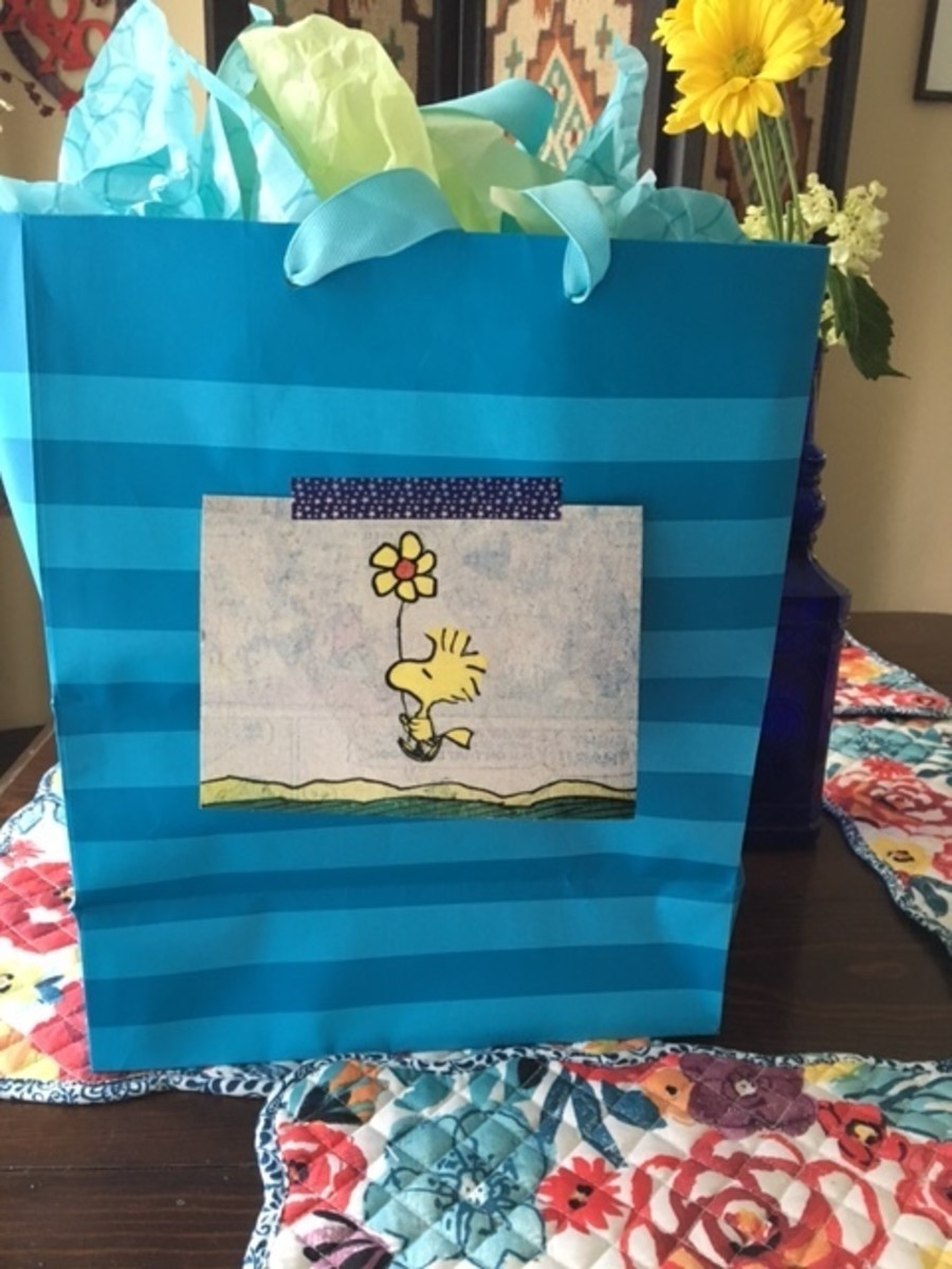 A gift for a friend, using a blank Snoopy card as a birthday card.