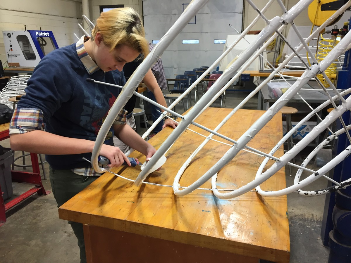 This high school student at the Governor's Academy for Engineering Studies is lending her engineering creativity to a rival high school's theater project.