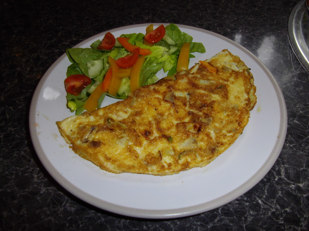Vegetable omlette with salad