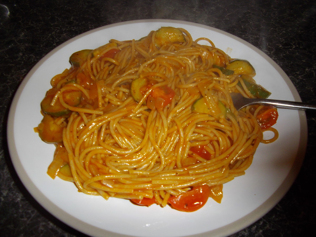 Pasta with courgette, onion and tomato sauce.