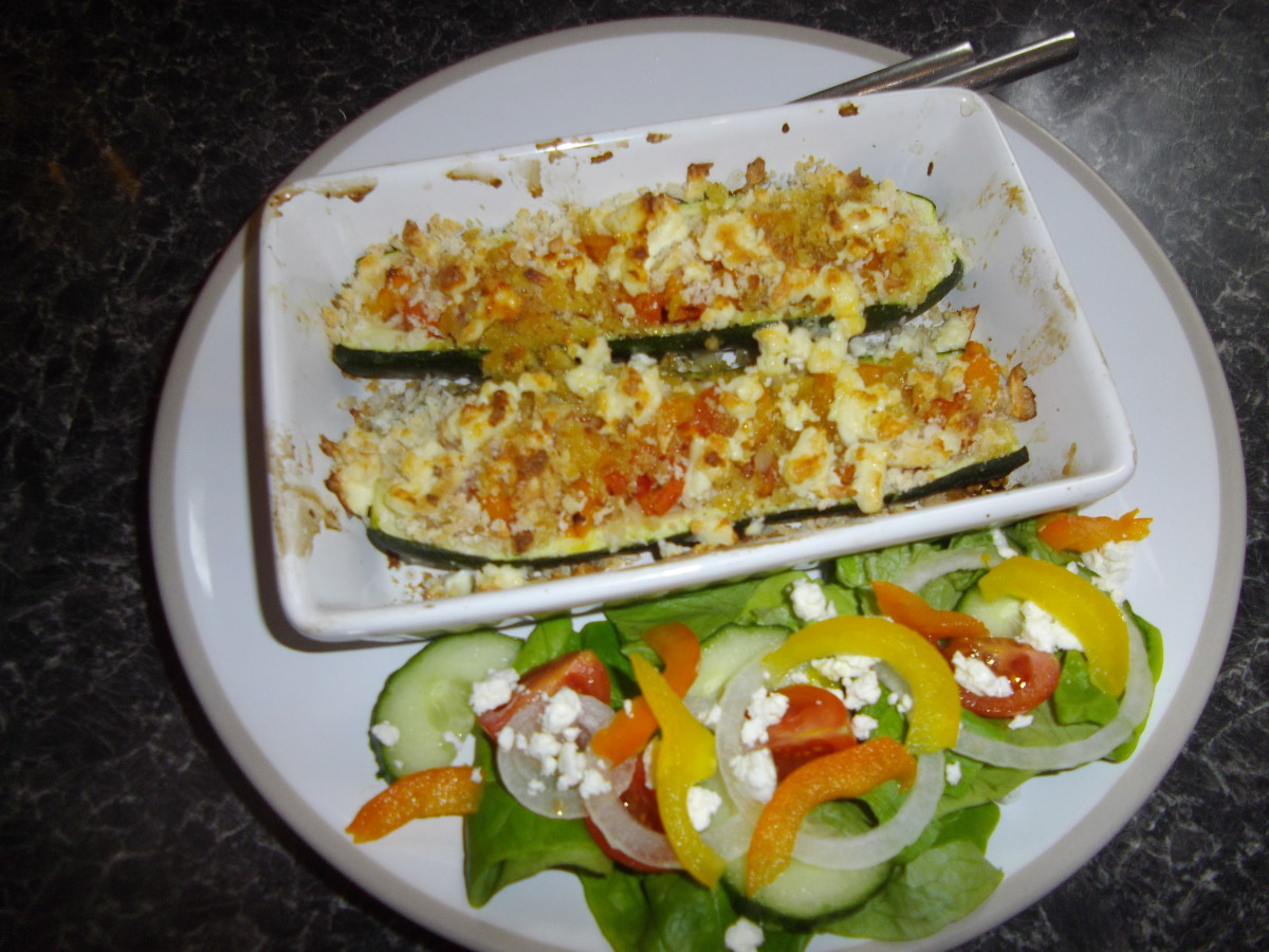 Stuffed courgette with feta cheese gratin and salad.
