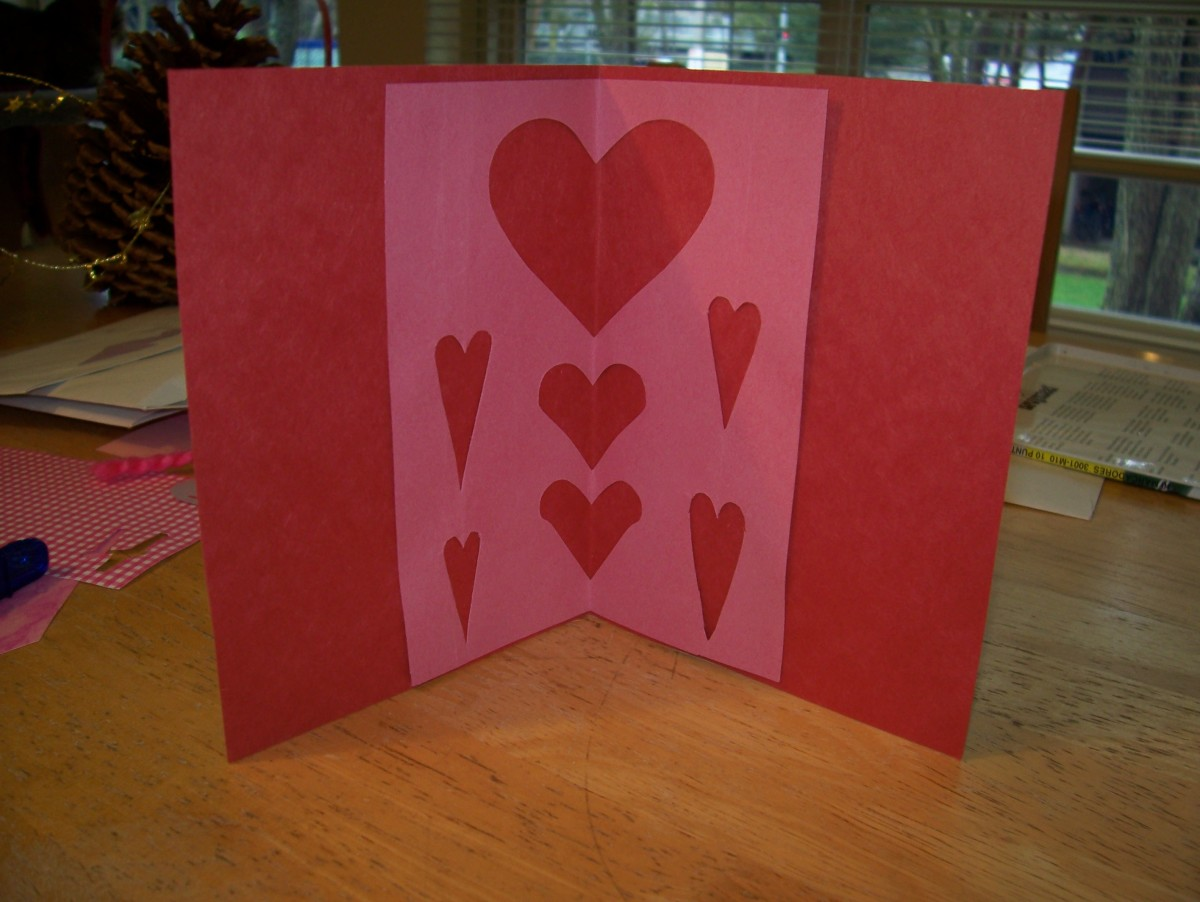 Then, when the card is opened, there will more hearts.
