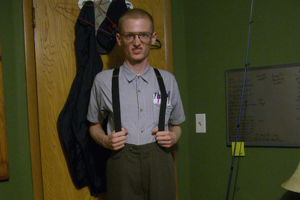 Stereotypical geek wearing suspenders