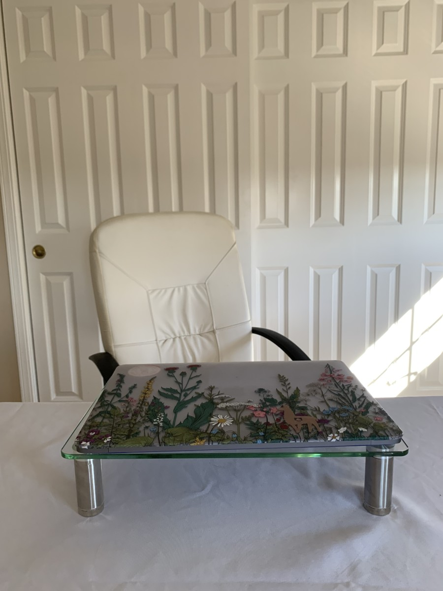 A pop-up table and a table cloth makes for a quick fix when creating a workspace anywhere in a home