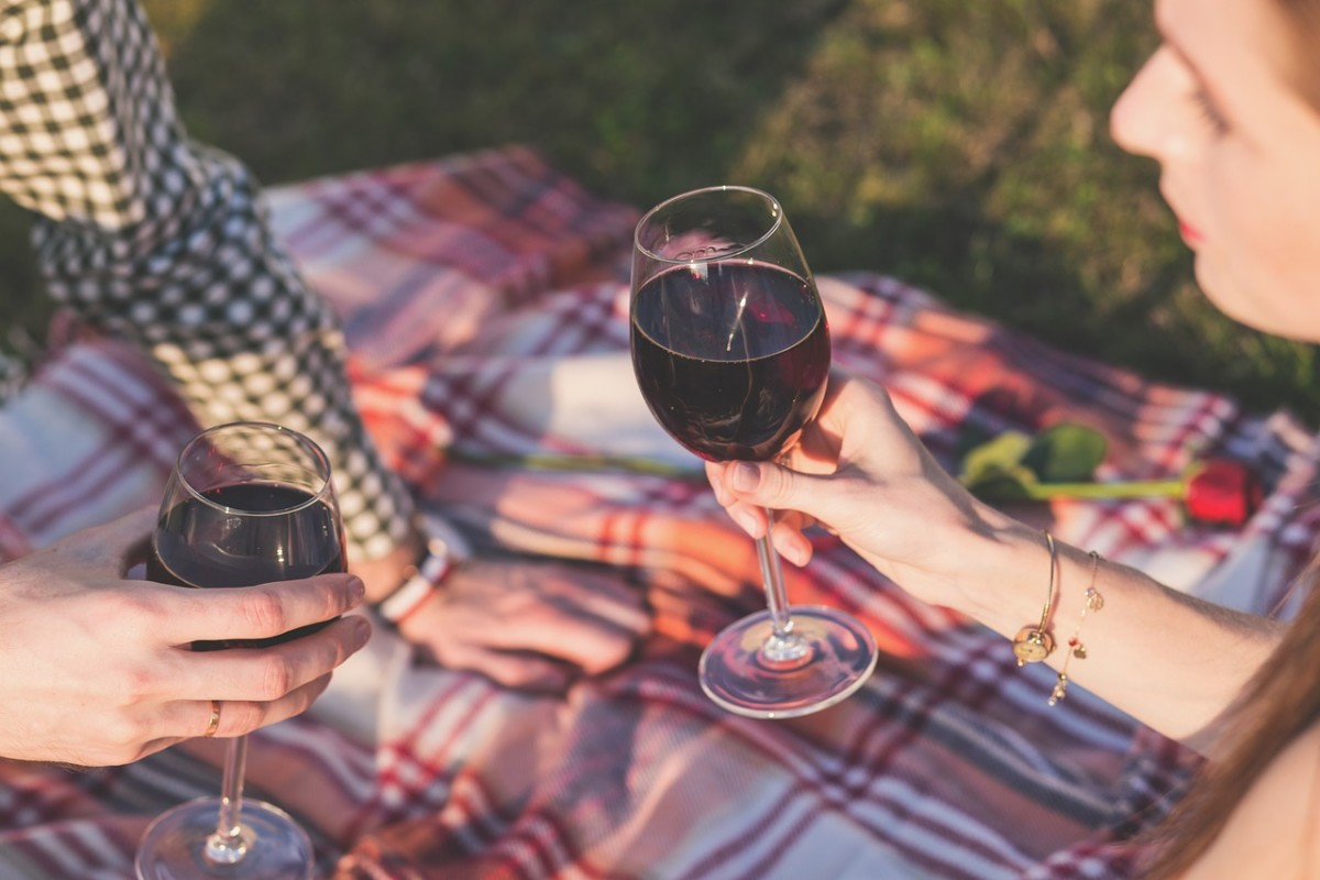 A surprise picnic in the vineyards after wine tasting is a great time to pop the question.