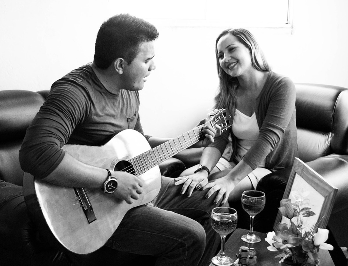 Serenading your girlfriend before the proposal is a great way to get her in the mood.