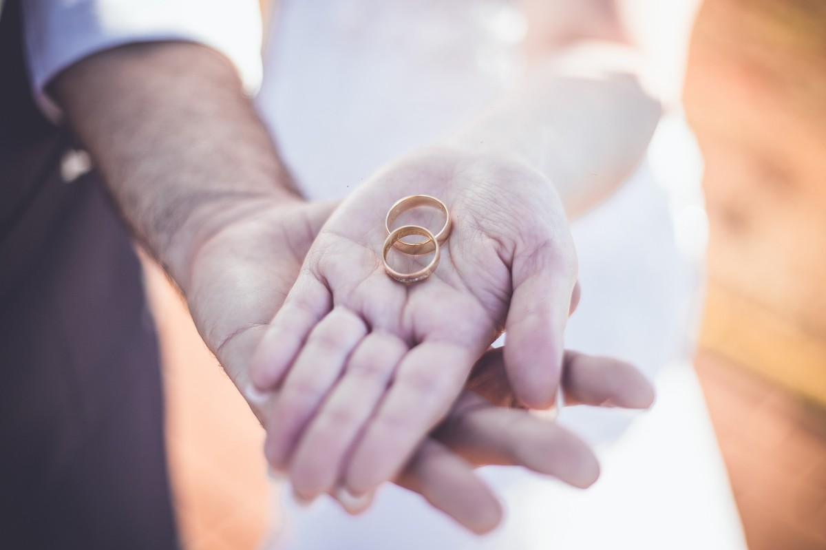 A couple is more likely to have the groom take the bride's name than reverse the traditional roles of who gets down on bended knee and does the proposing.