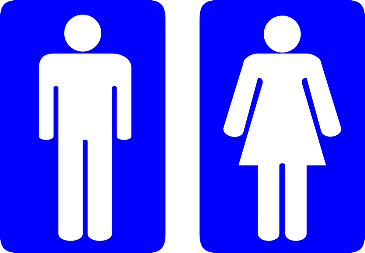 Let your friend decide what kind of man or woman they want to be. (Also, yes, they will probably be switching bathrooms, FYI.)