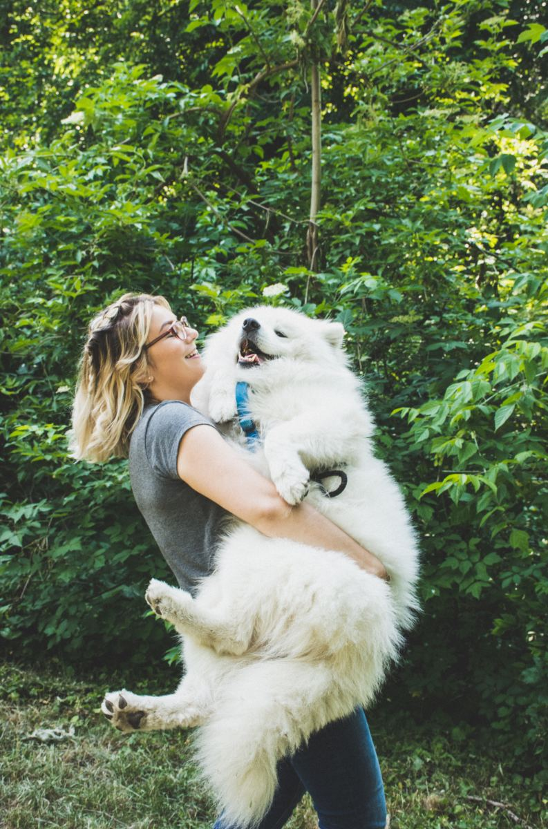 100% she's making him talk out loud about how grateful he feels that she's willing to lug his sweaty fur across the park so he doesn't have to walk another step.