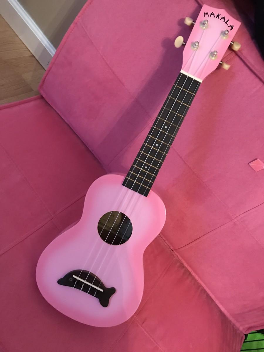 My Makala Dolphin soprano ukulele in pink burst.