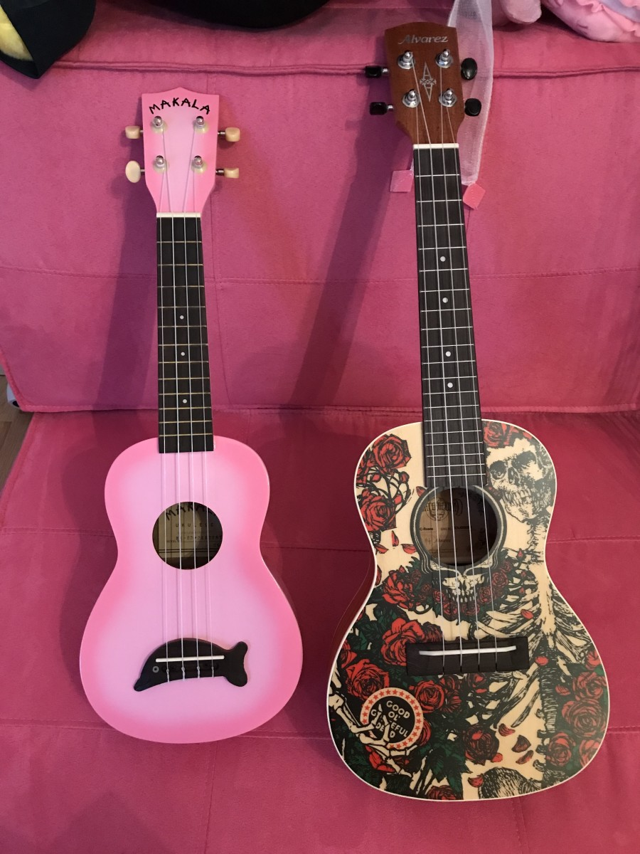 Both of my ukuleles together. Makala Dolphin soprano and Alvarez Grateful Dead concert.