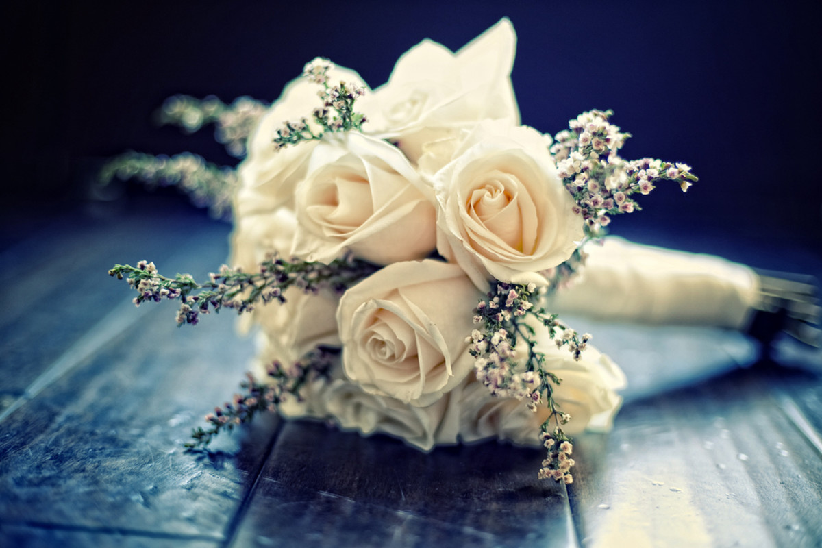 White roses and soft colors are an enduring favorite for wedding bouquets.