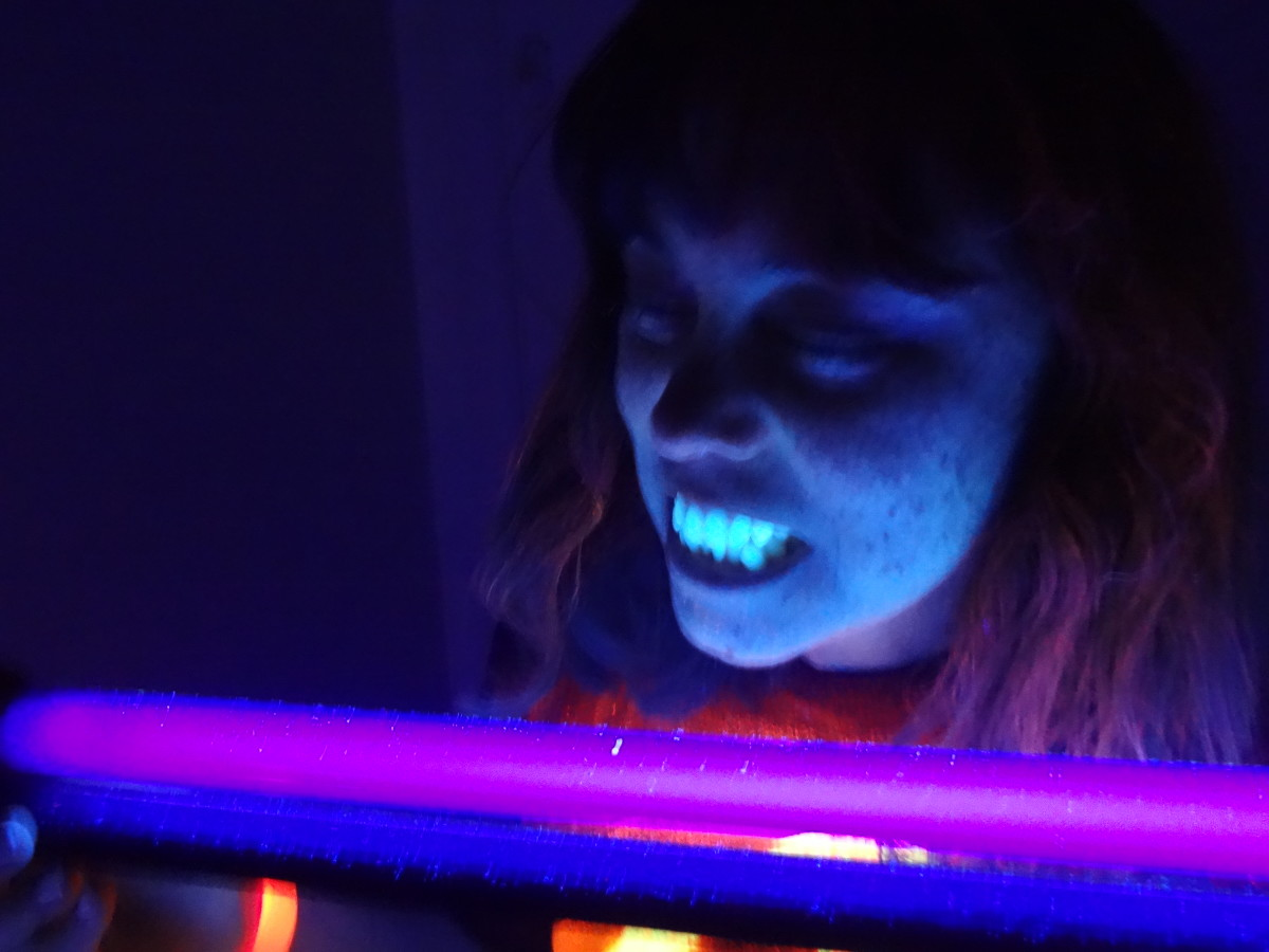 Fluorescent hair spray creates the pink tint in my hair. (Teeth and freckles definitely show up under a black light.)