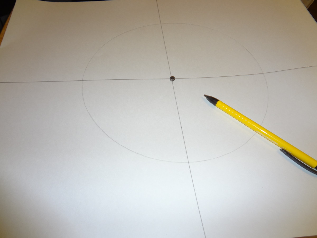 Divide the poster board into fourths and then draw a circle in the middle.