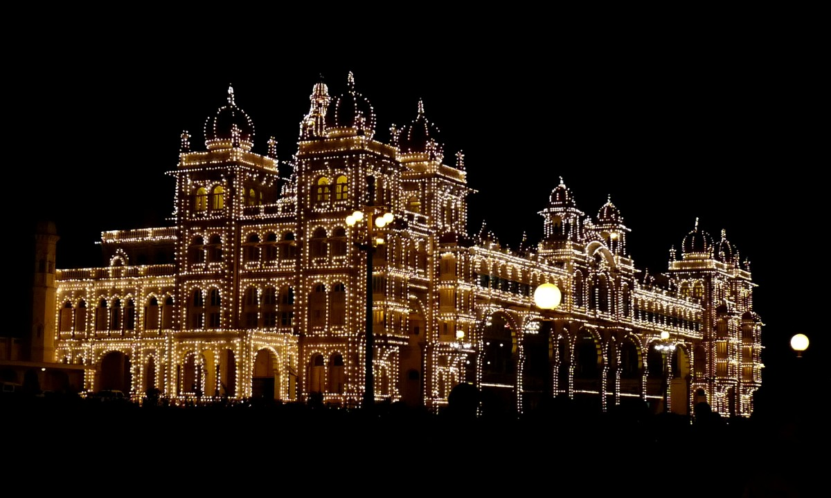 Mysore Palace illuminated at night.