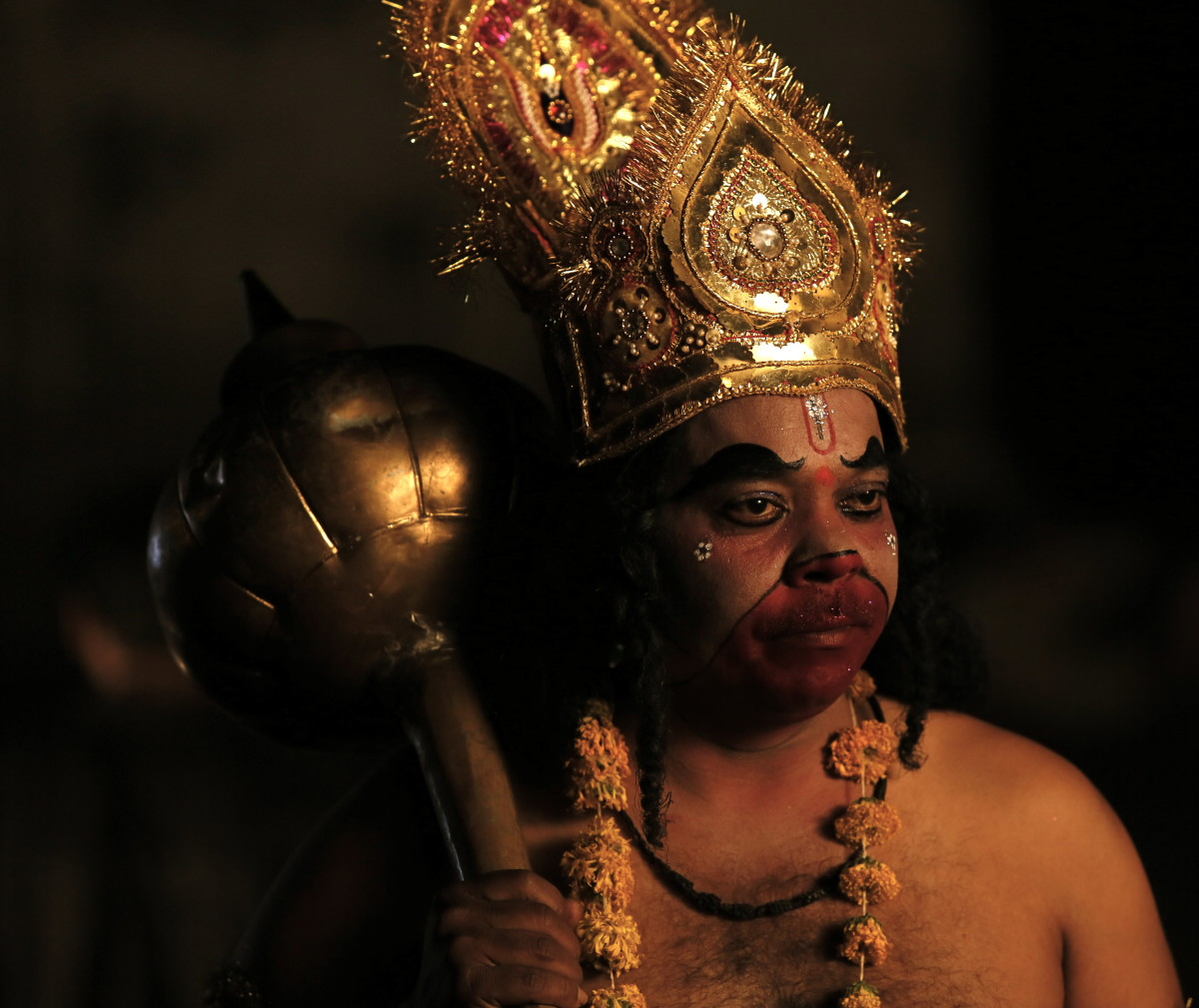 An actor dressed as Hanuman
